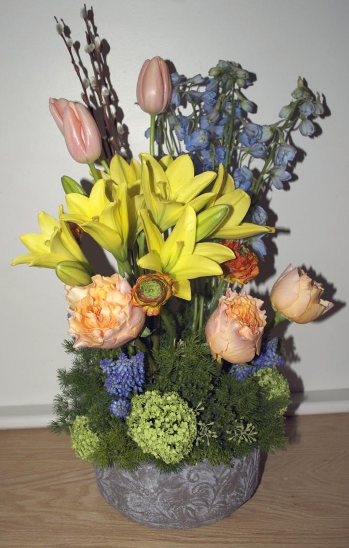 Spring Flower Arrangement Lillies Tulips In Decorative Container