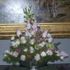 Bring color and artistry to your party with a custom designed floral arrangement by Helen Stock