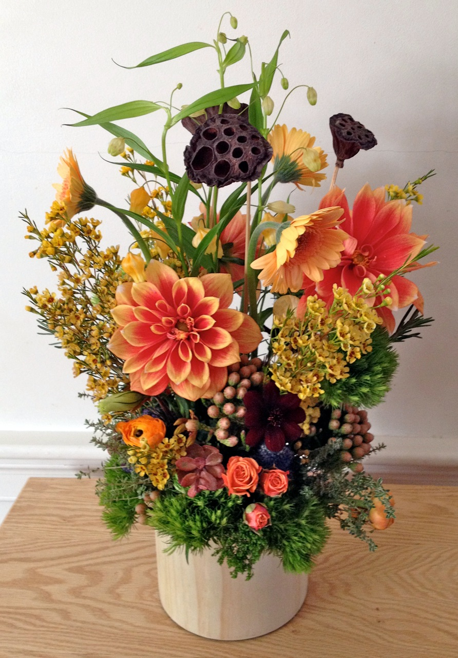 Magnificent colors and the use of open space are reflected in this custom floral design by one of Massachusett's most talented custom floral designers, Helen Stock