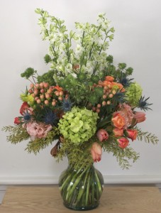 Both whimsical and delicate, this custom floral arrangement by Helen Stock designs is further enhanced by the choice of vase