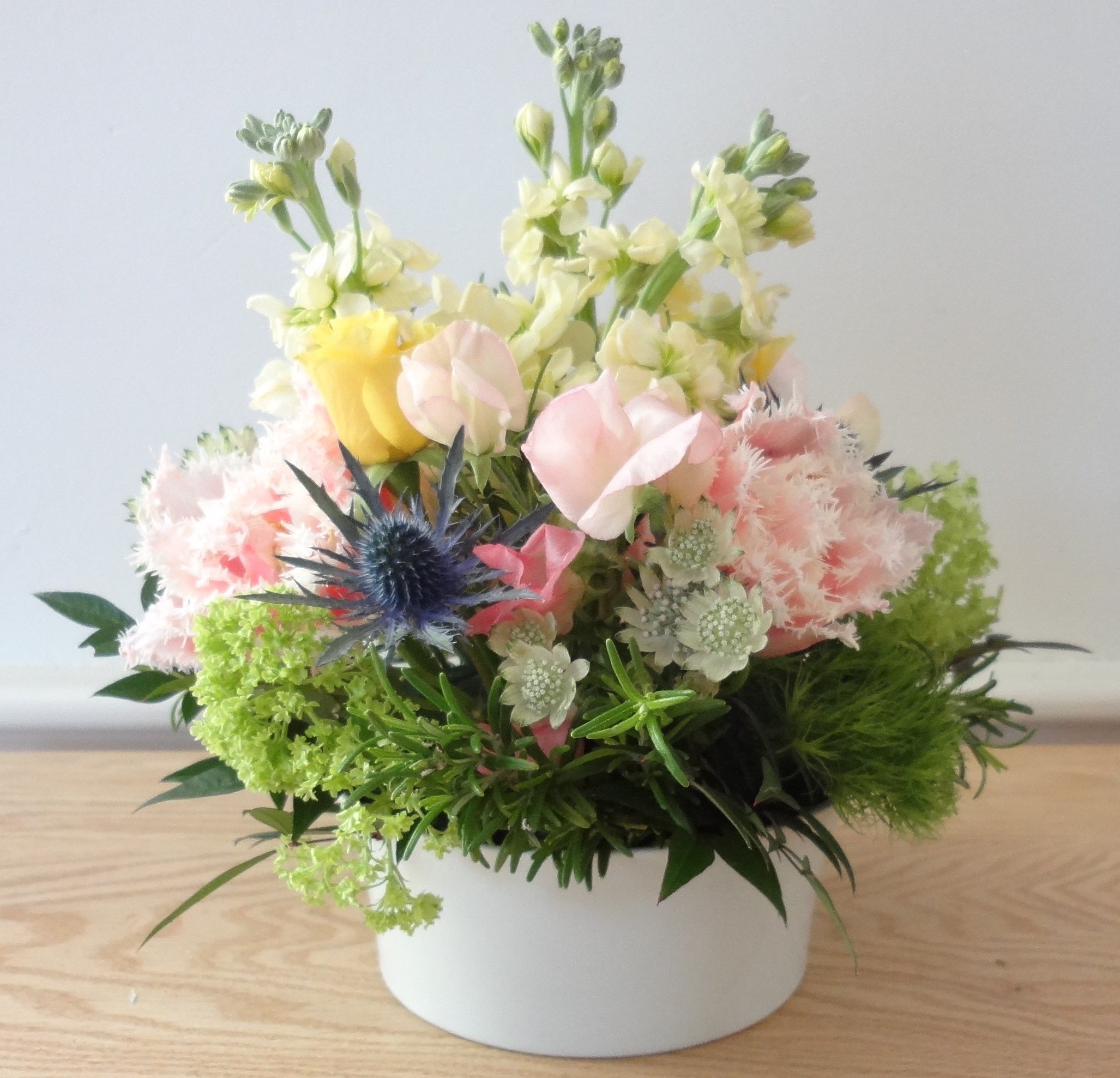 Small pastel flower arrangement white vase helen stock for Small rose flower arrangement